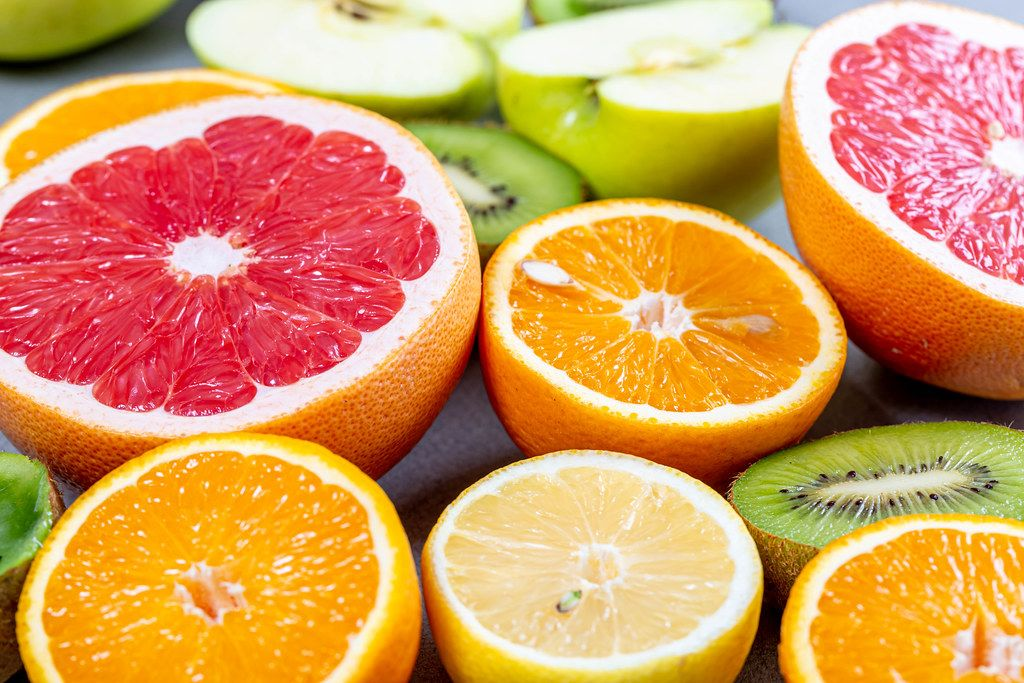 Halves of different ripe, fresh fruit. Healthy food concept
