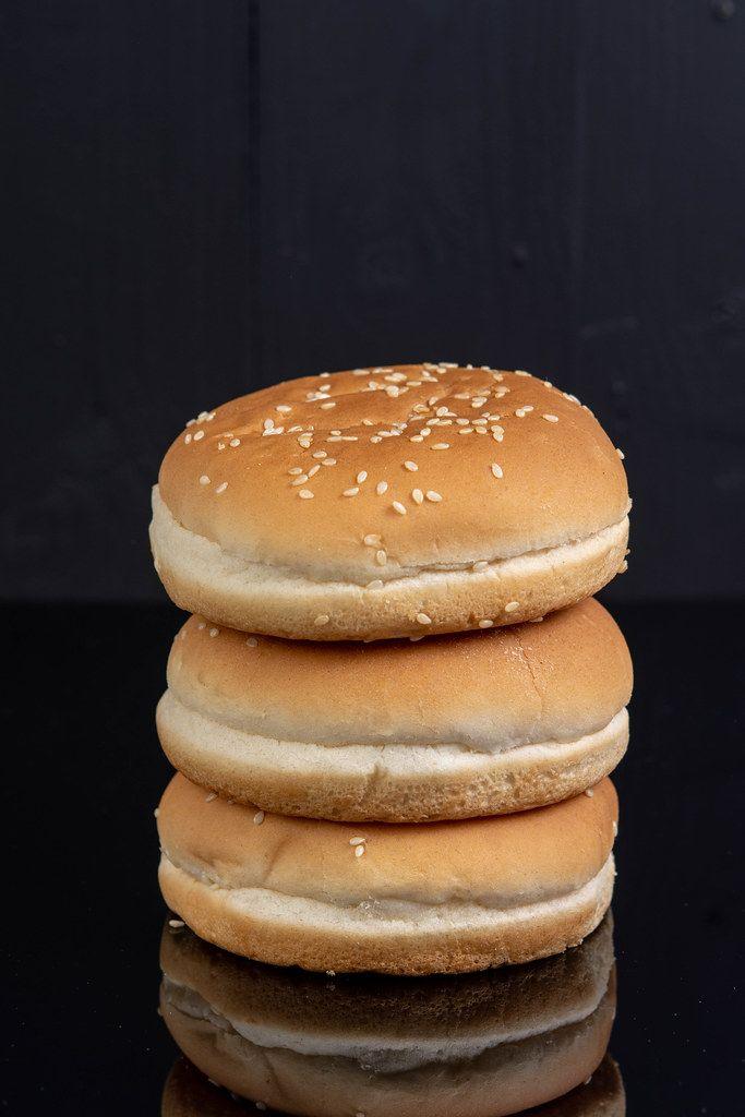 Hamburger Buns isolated above black background