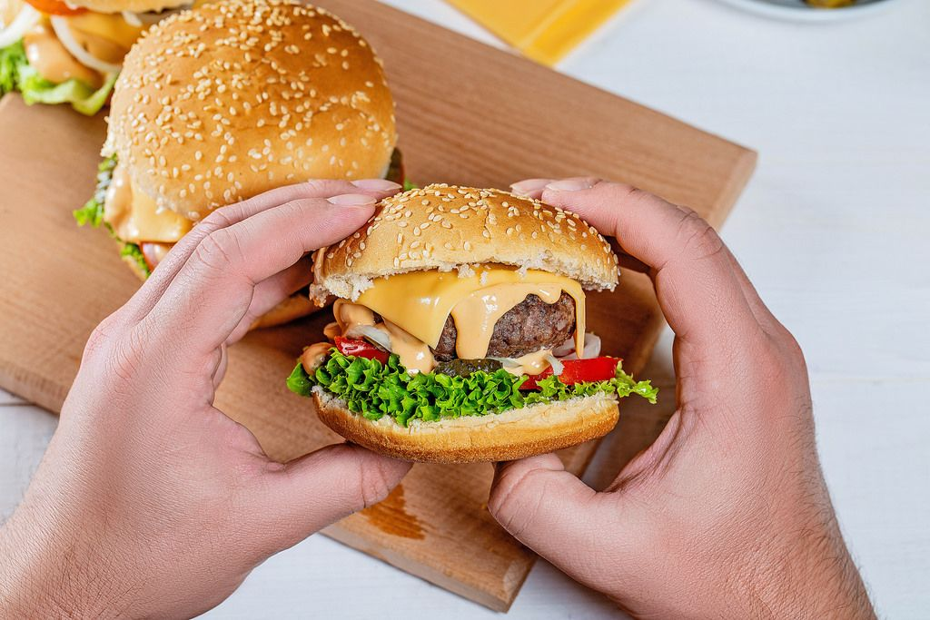 hamburger in the hands of a man