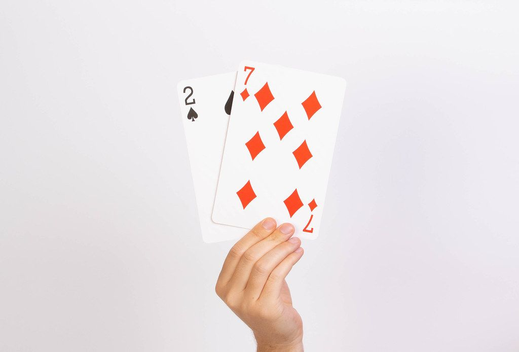 Hand holding deuce and seven playing cards.jpg
