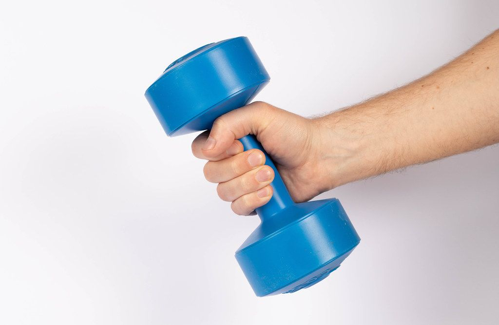 Hand holding dumbbell on white background (Flip 2019)