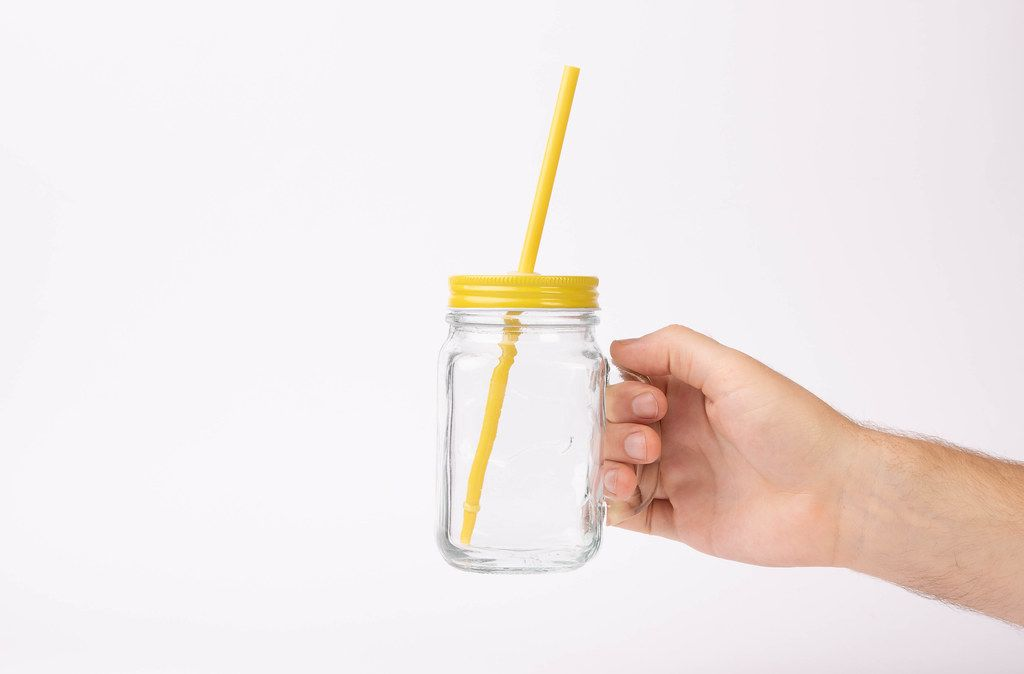Hand holding glass with drinking straw (Flip 2019)