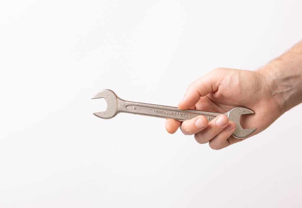 Hand holding handle wrench (Flip 2019)