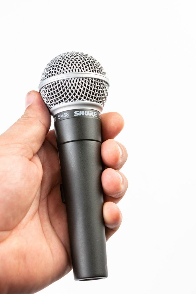 Hand holding Vocal Microphone