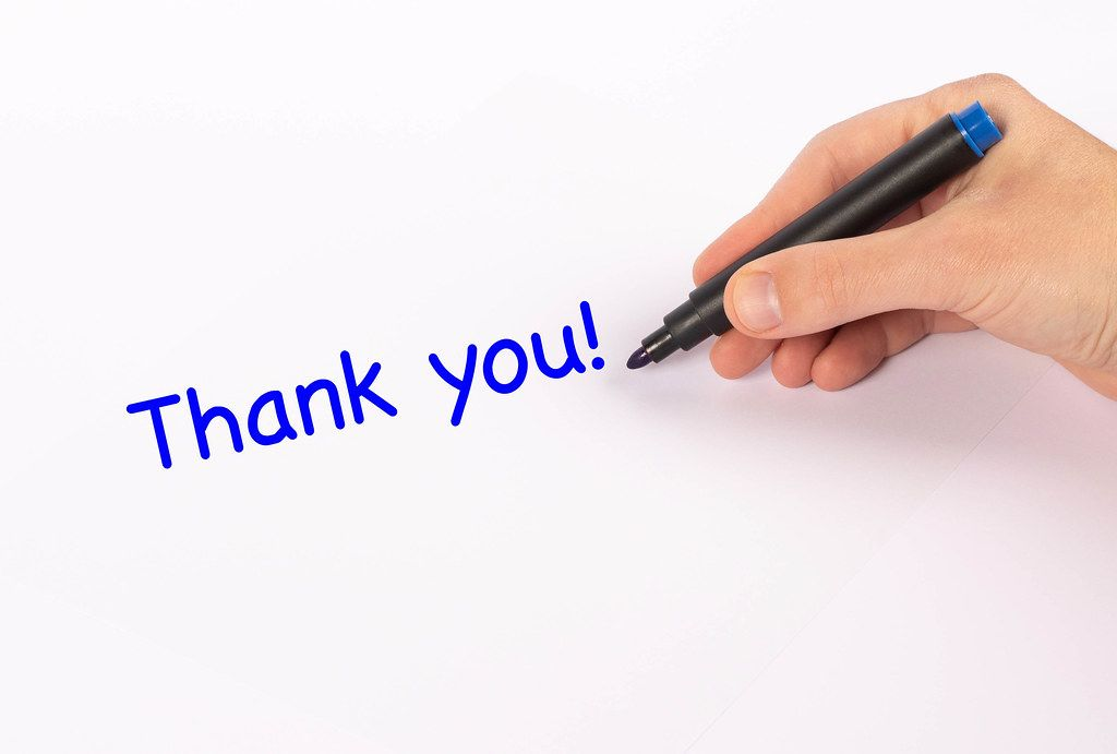 Hand with marker writing Thank you! text