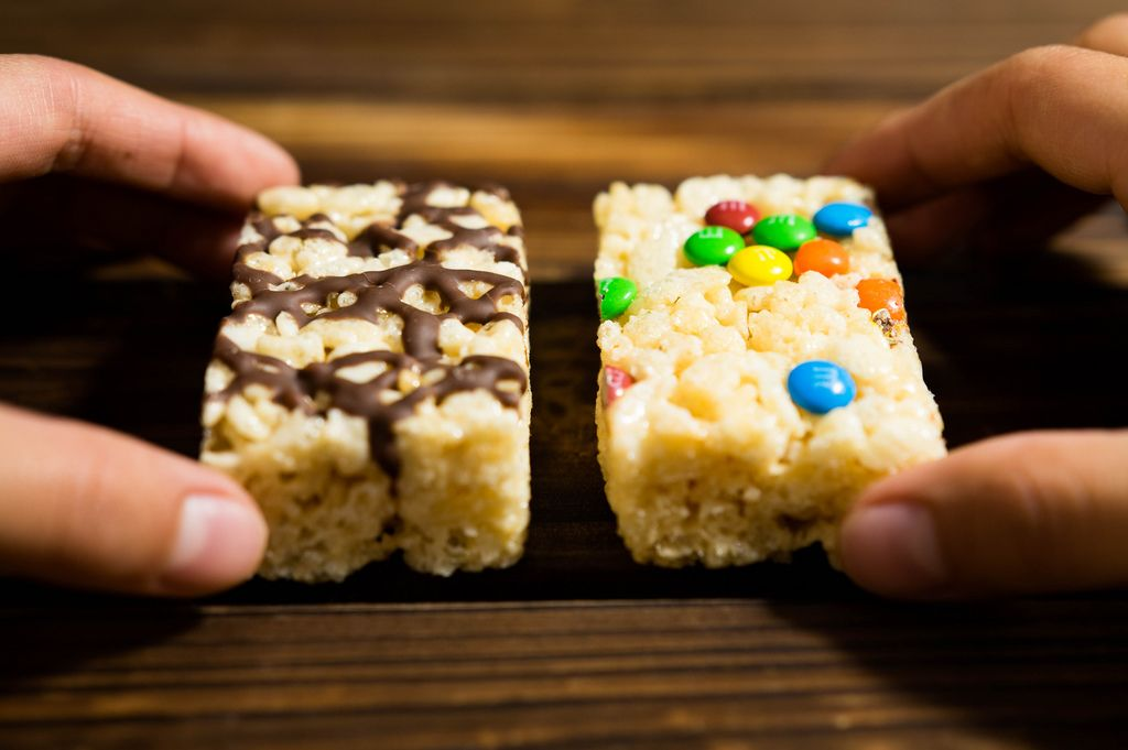 Hands holding two rice krispies blocks