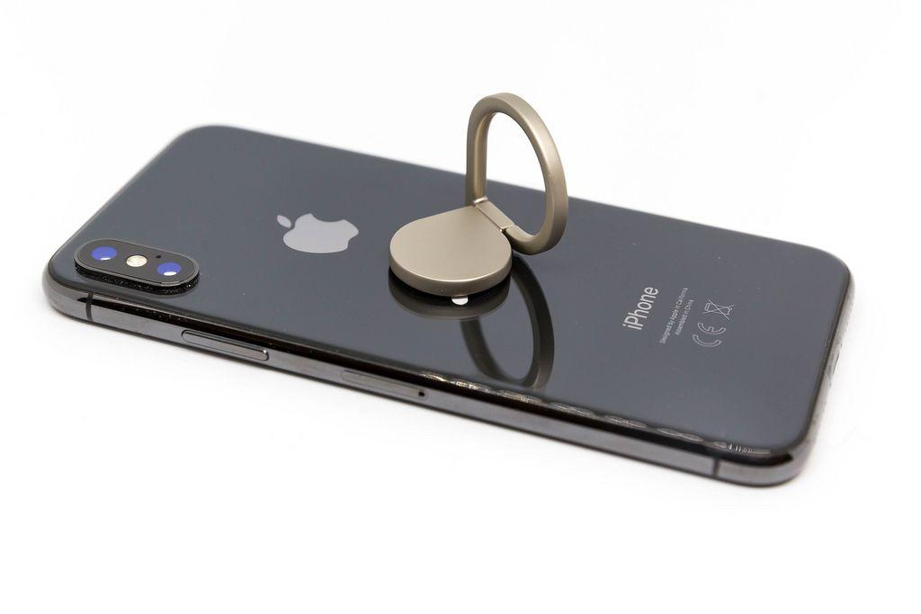 mobile phone finger ring stand bilder und fotos. Black Bedroom Furniture Sets. Home Design Ideas