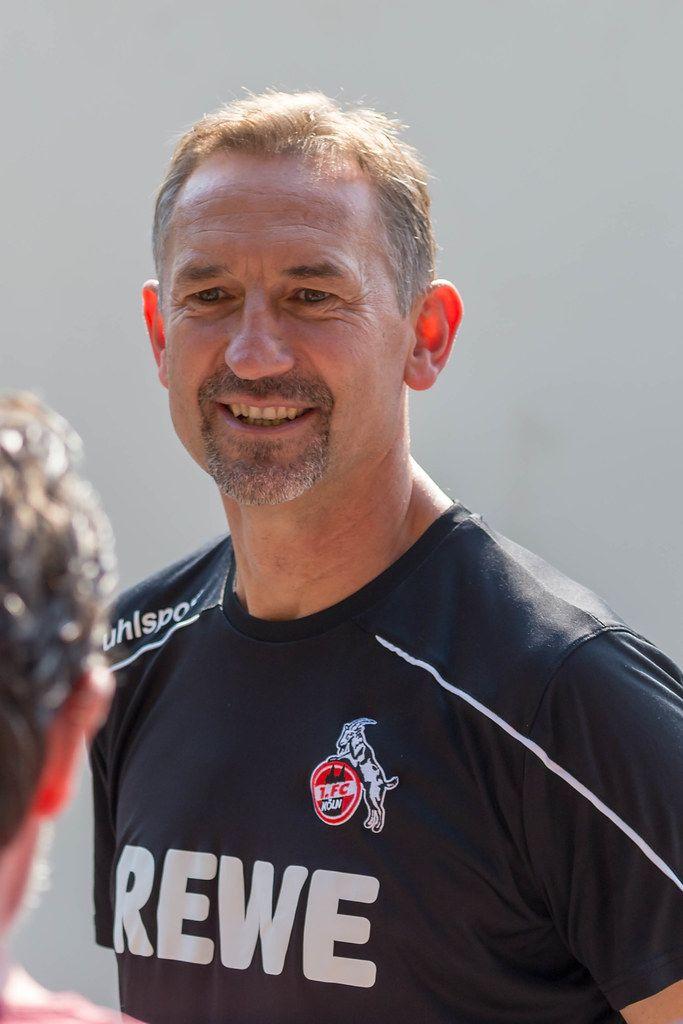 Happy soccer trainer Achim Beierlorzer smiling after team training