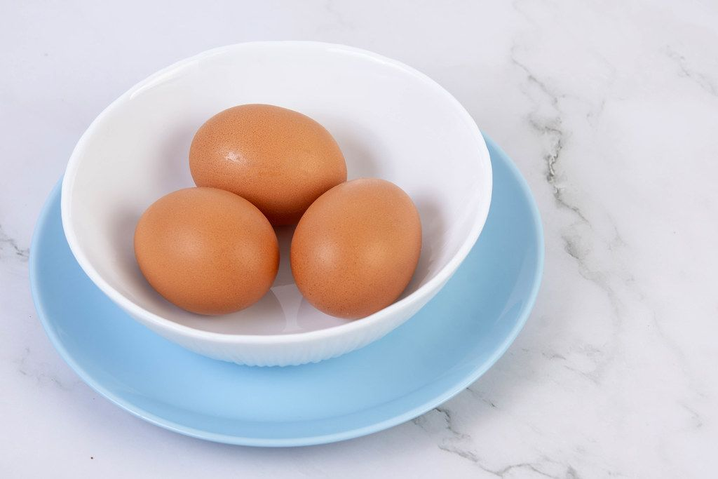 Hard Boiled Eggs in the bowl above grey marble table (Flip 2019)