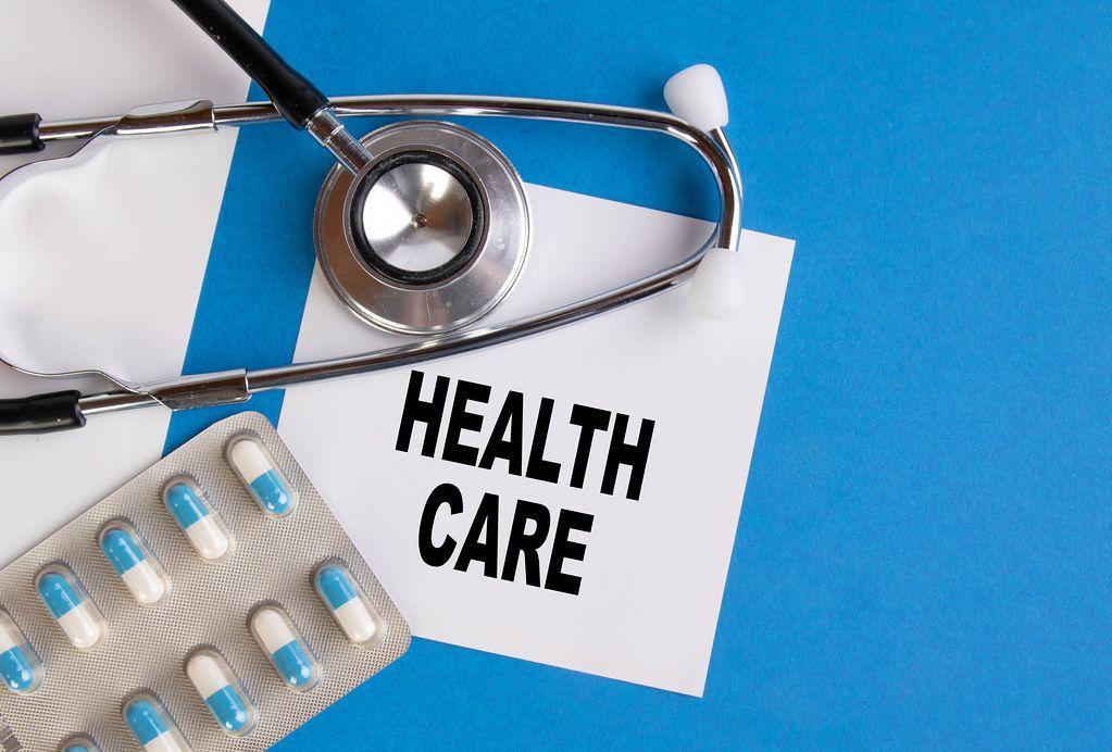Health care written on medical blue folder