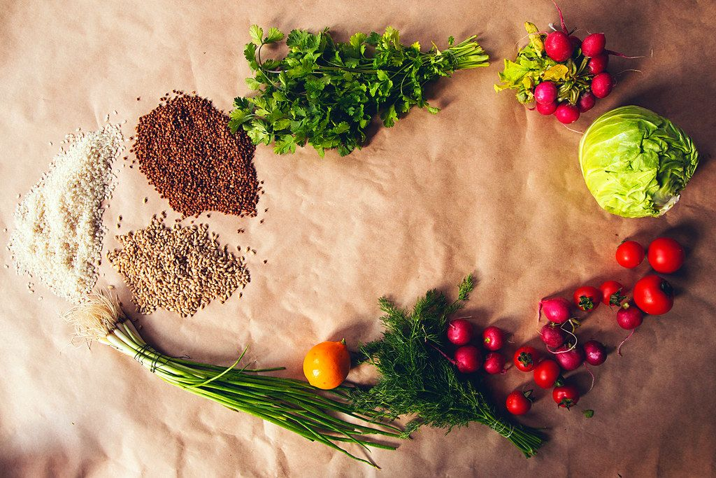 Healthy food background. Assortment of fresh vegetables and cereals on paper background (Flip 2019)