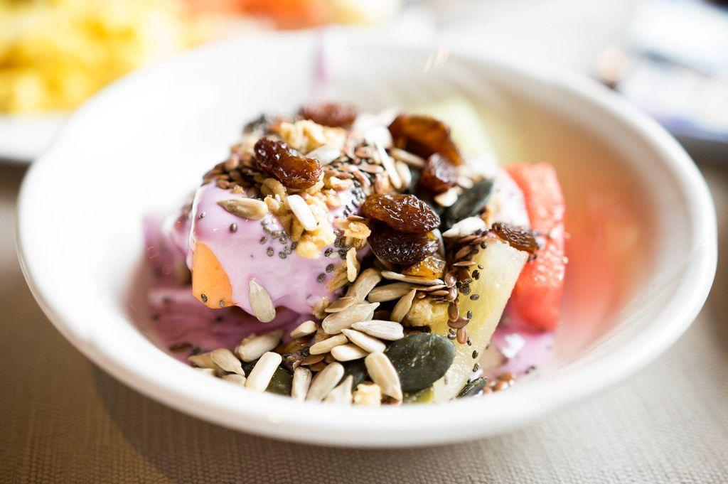 Healthy fruit bowl with yogurt, seeds, and dried berries (Flip 2019)