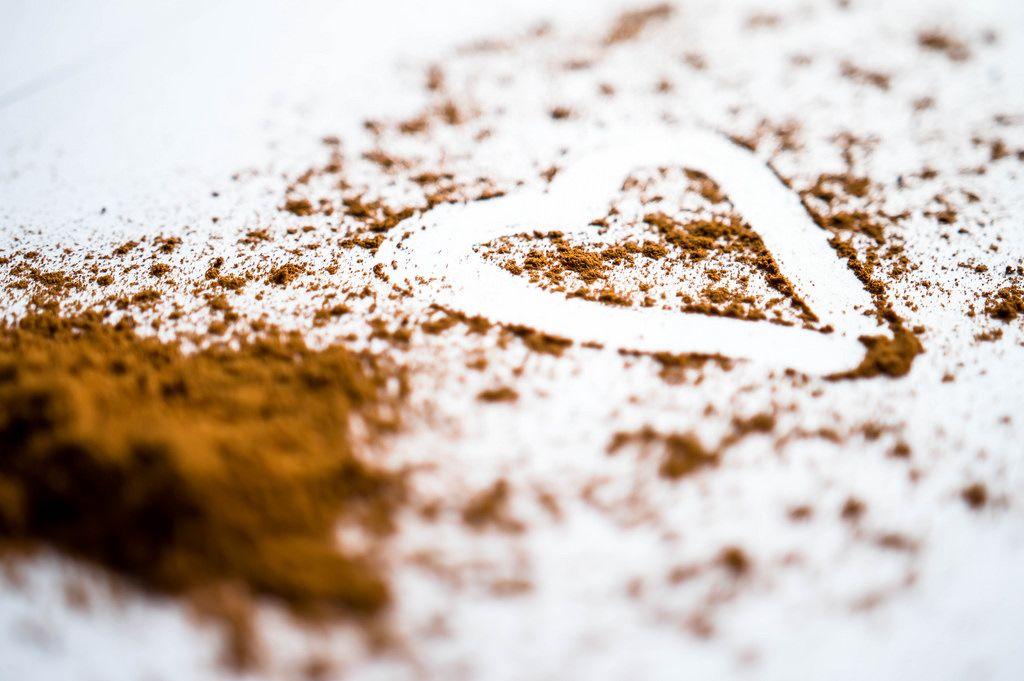 Heart traced over cinnamon powder