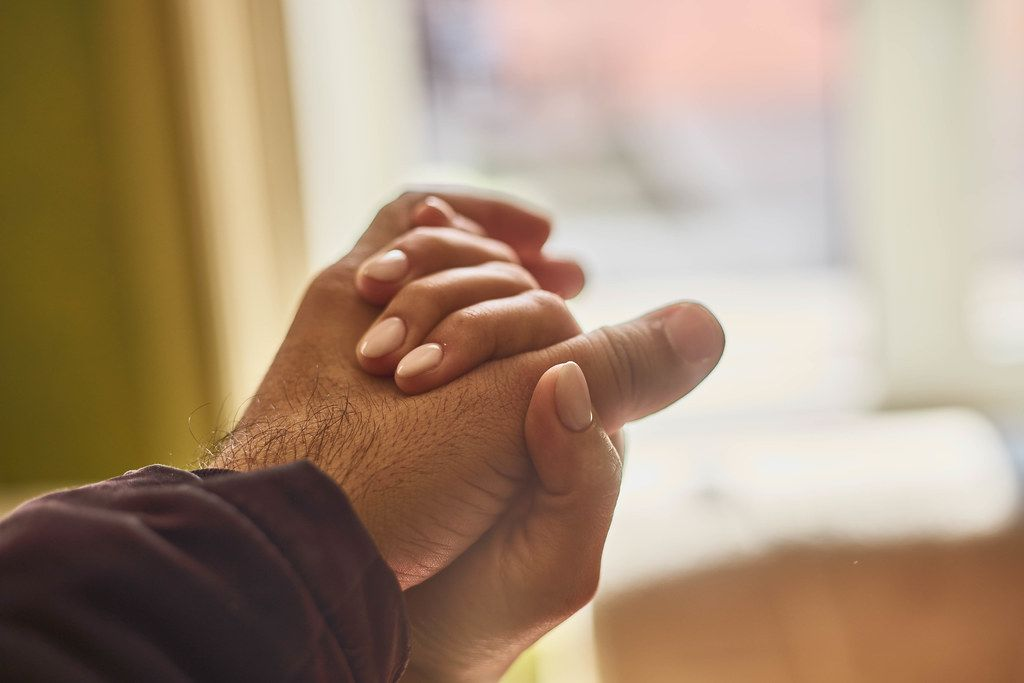 Helping hands. Close-up view of two unrecognizable people holding hands in comfort
