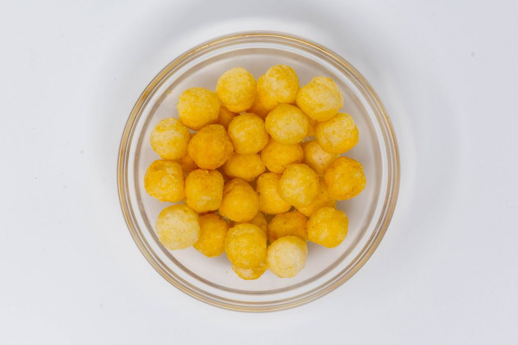 High Angle Shot - ape - Vegan Coconut and rice puff balls with cheese flavour