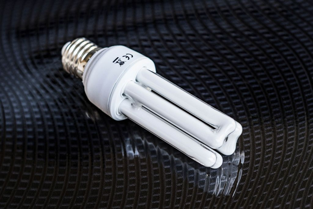 High Angle View of Fluorescent Light Bulb on Black Table