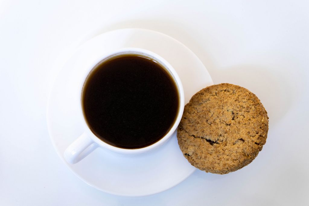 High Angle View Of The Cookie And Coffee On The White Background
