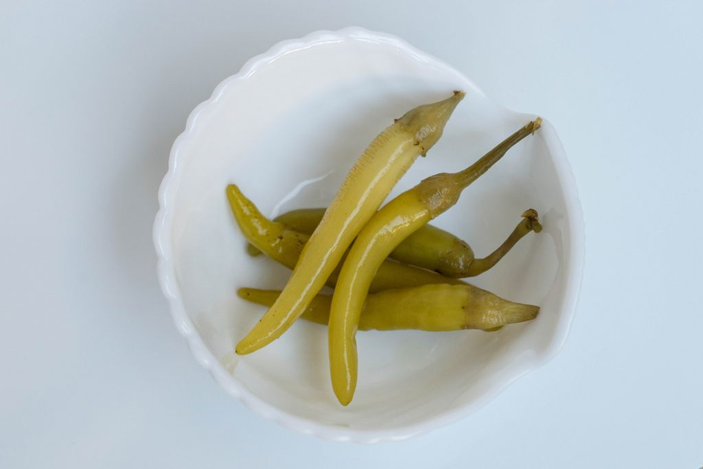High Angle View of the Green Chilly Peppers in White Bowl