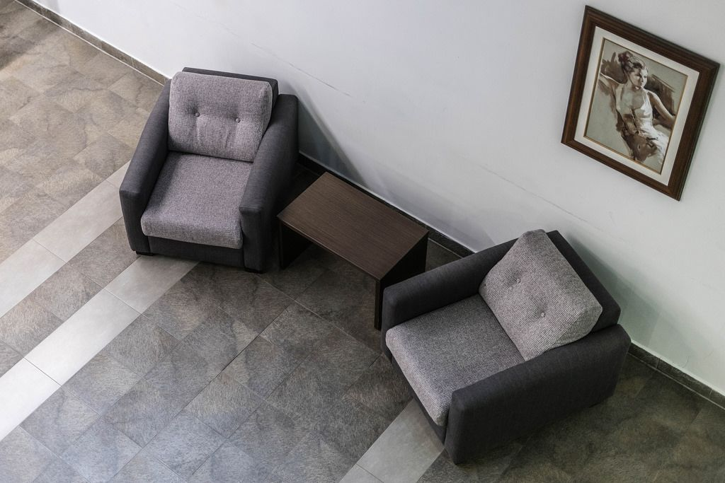 High Angle View of the Two Armchairs at the Hallway