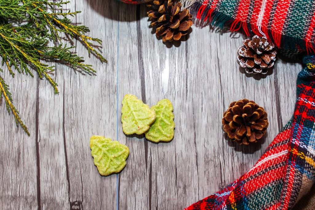 Holday Background with Pinecone, Cookies and Tree Branch