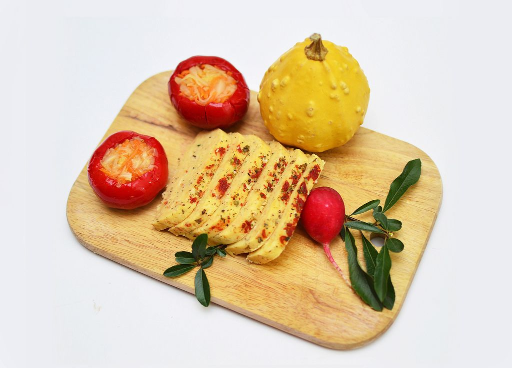 Homemade cheese with peppers and herbs