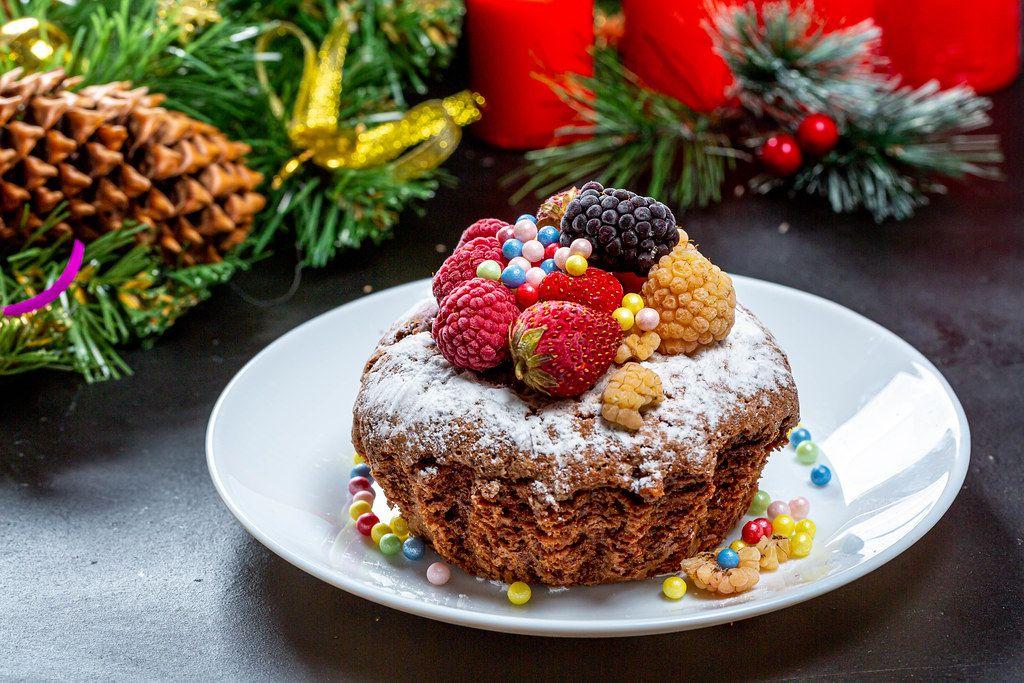 Homemade Christmas cupcake with strawberries, raspberries and mulberries