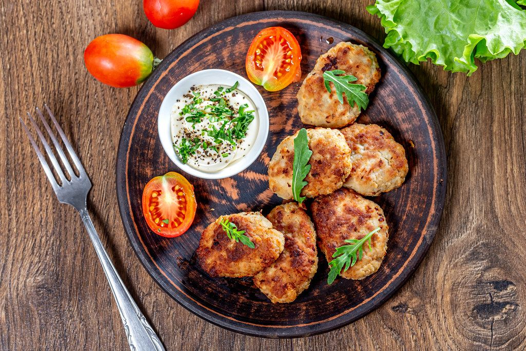 Homemade fried meat cutlets with sauce and herbs (Flip 2019)