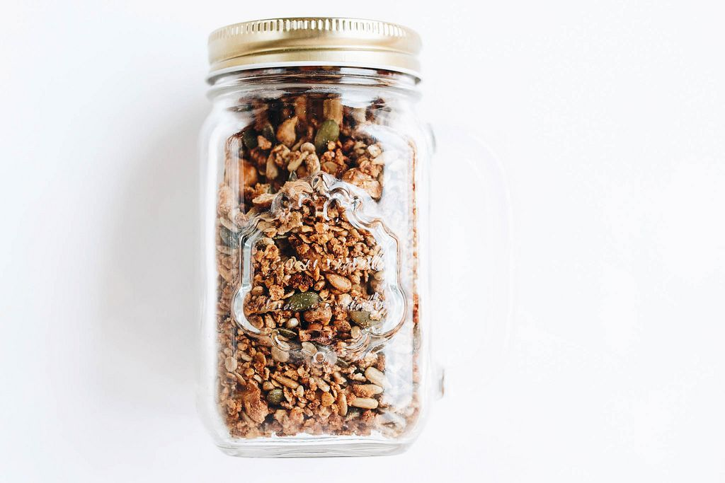 Homemade granola in a jar. Healthy food on white background
