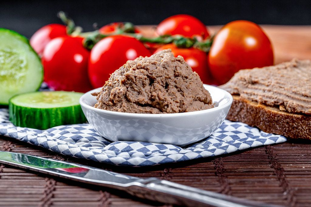Homemade liver pate with vegetables and black bread