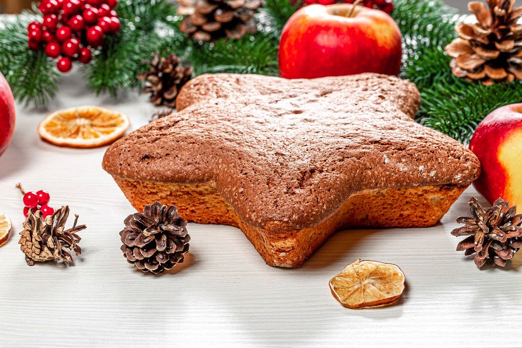 Homemade sponge cake in the shape of a star on a Christmas background (Flip 2019)