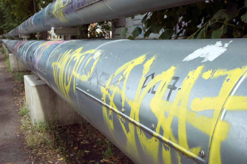 Huge pipe covered in a graffiti in the central part of Berlin, Germany