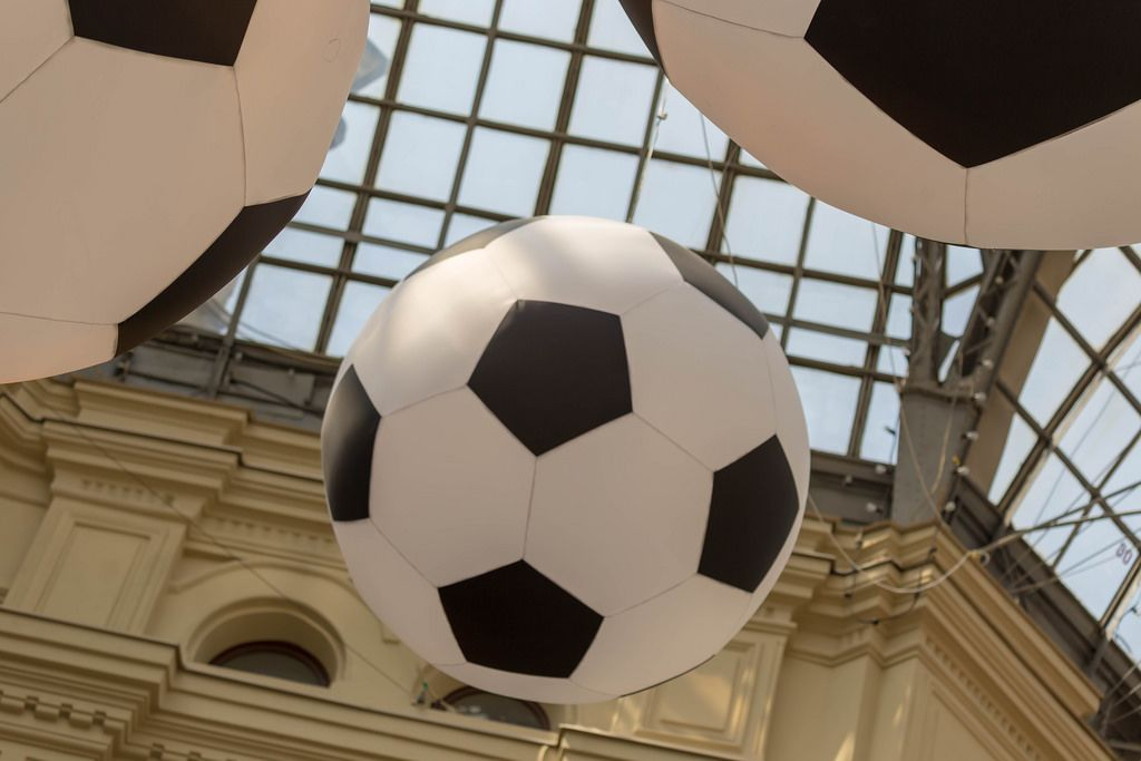 Huge soccer balls hanging from the ceiling