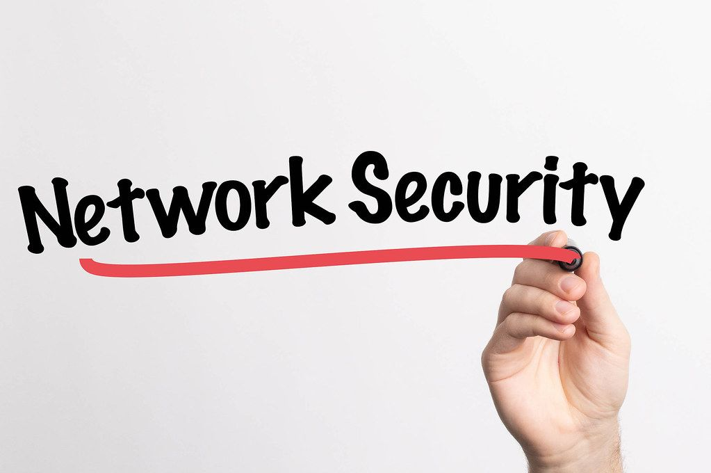 Human hand writing Network Security on whiteboard