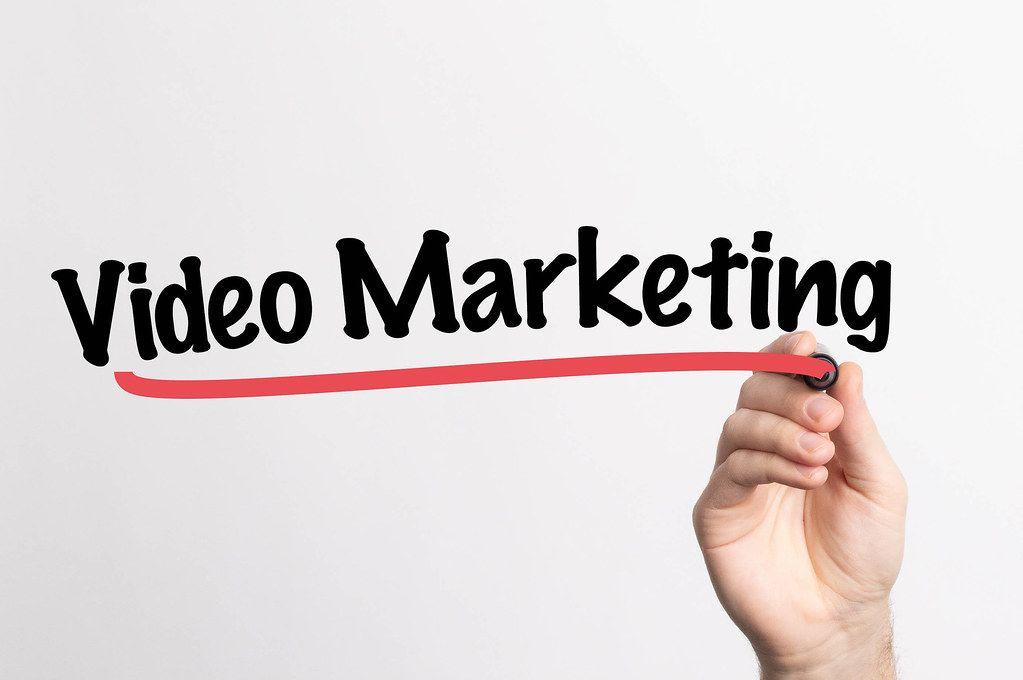 Human hand writing Video Marketing on whiteboard