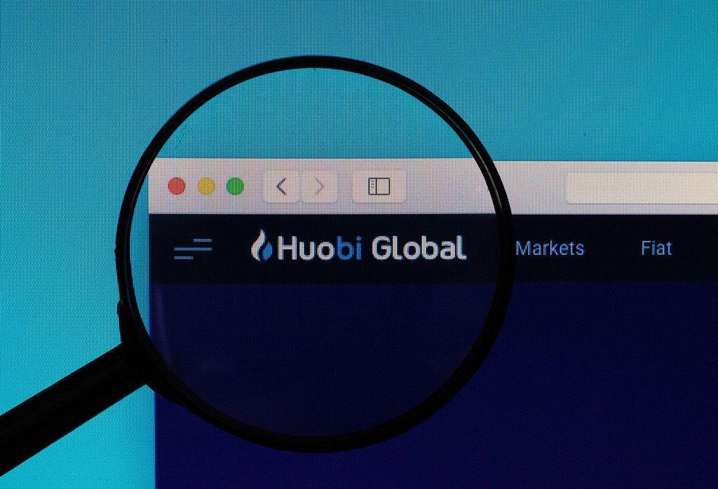 Huobi Global logo under magnifying glass