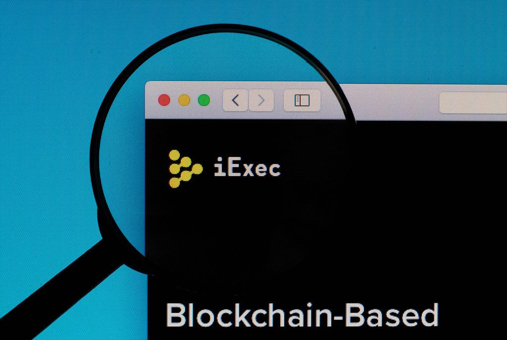 iExec logo under magnifying glass