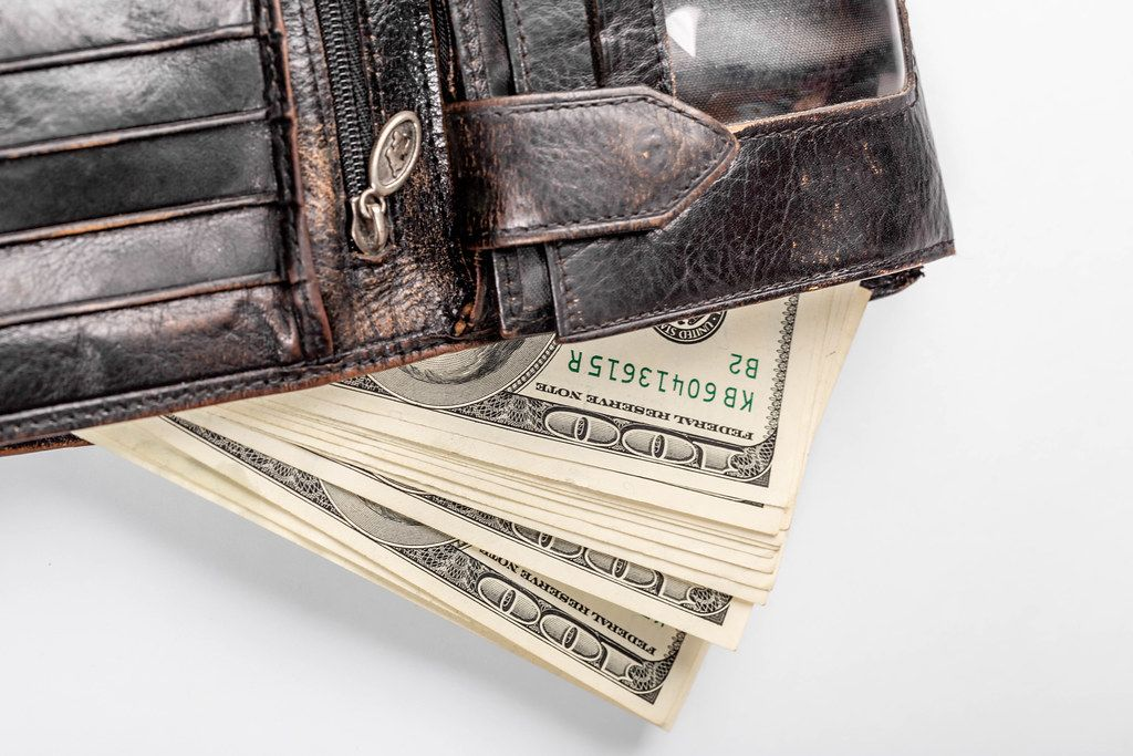 In the black leather wallet dollars banknotes
