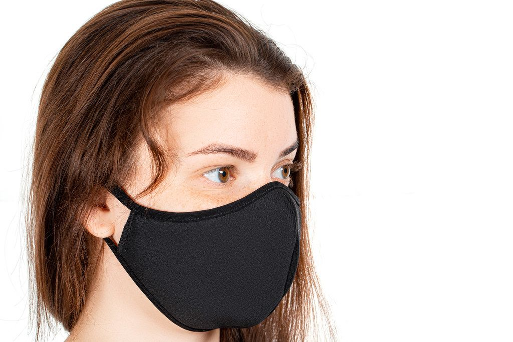 Infectious disease prevention concept, girl face in black medical mask