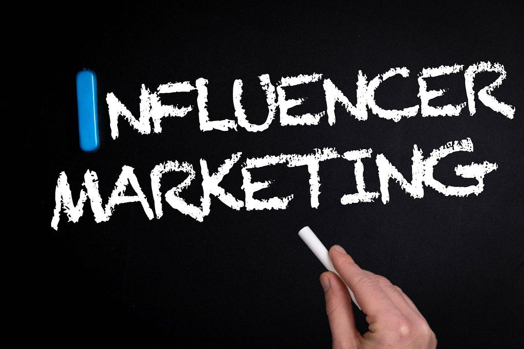 Influencer marketing text on blackboard