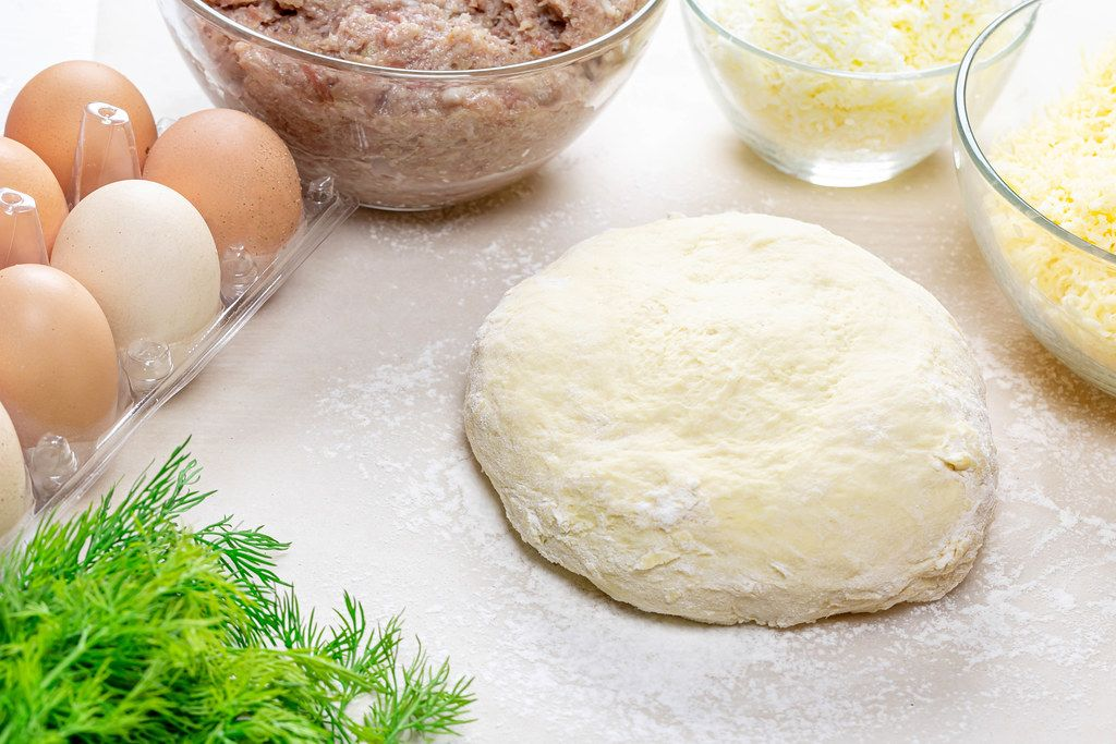 Ingredients on the kitchen table for making khachapuri