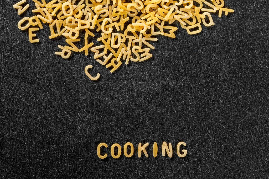 Inscription Cooking. Macaroni background