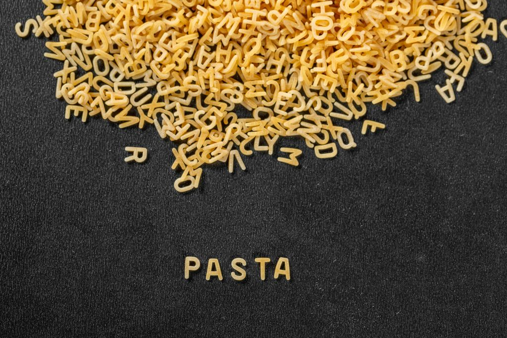 Inscription Pasta on the background of the letters