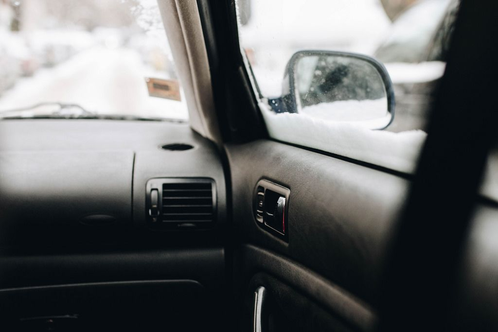 Inside view of a car. Focus on the door.
