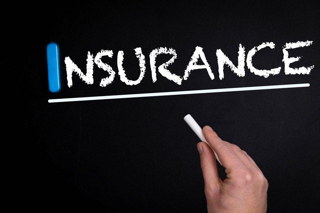 Insurance text on blackboard