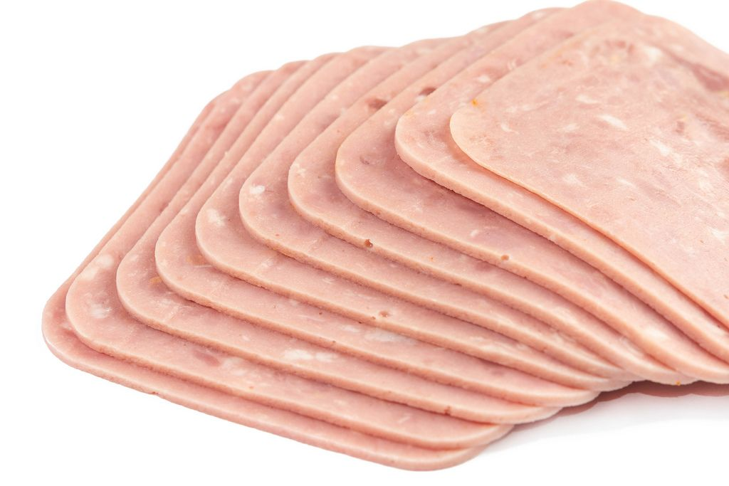 Isolated Sliced Square Ham above white background