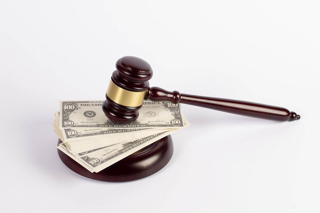 Judge gavel and money on white background