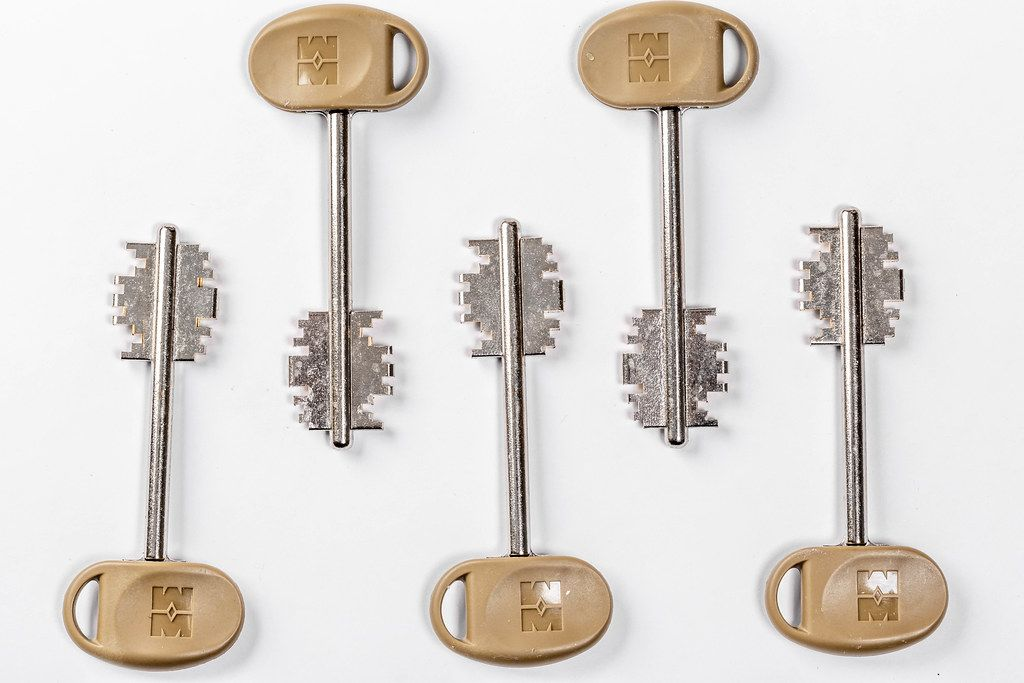 Keys to the door lock on white background