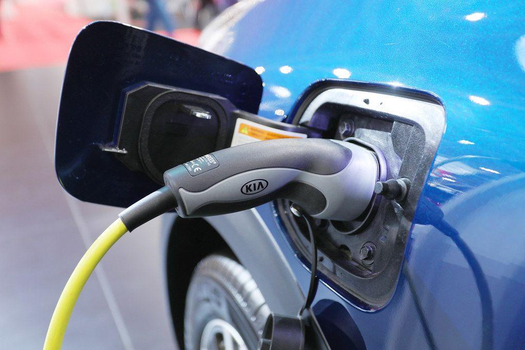 Kia car at charging station, electric car