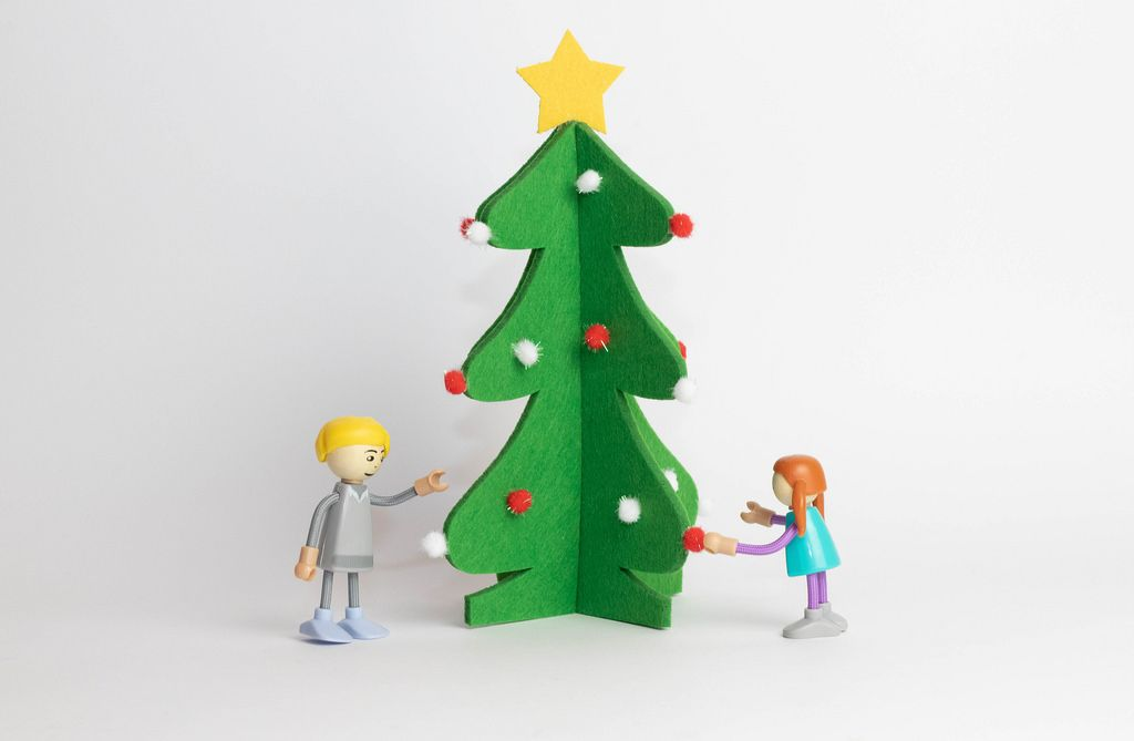 Kids decorating Christmas tree