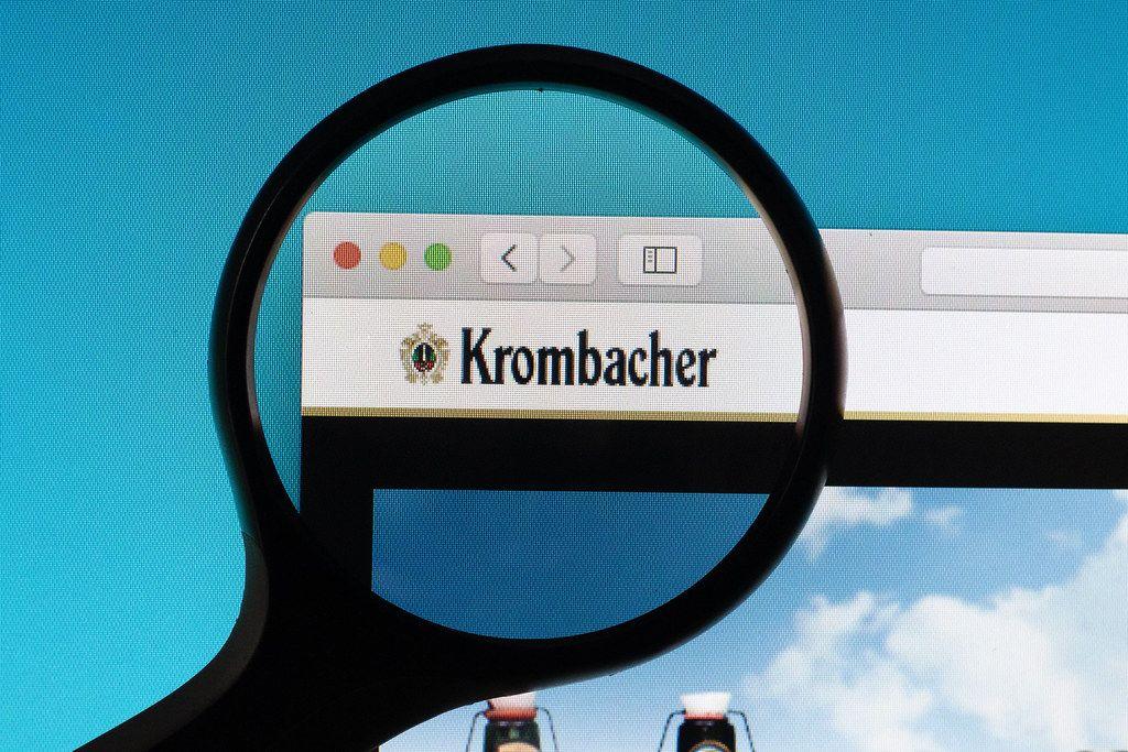 Krombacher logo under magnifying glass